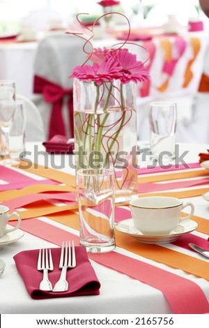 very cool and hip wedding table settings for a funky fresh young bride and groom. Shallow depth of field with the focus on the fork and glass. One of several in this series. - stock photo