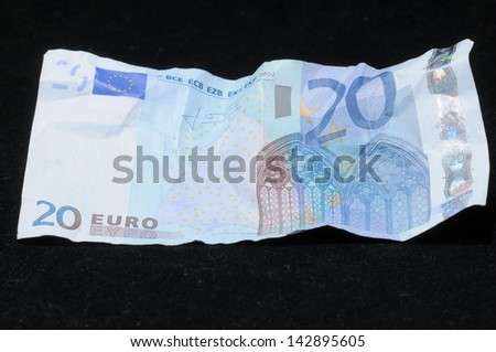 Very Crumpled Banknotes Money over a Black Background - stock photo