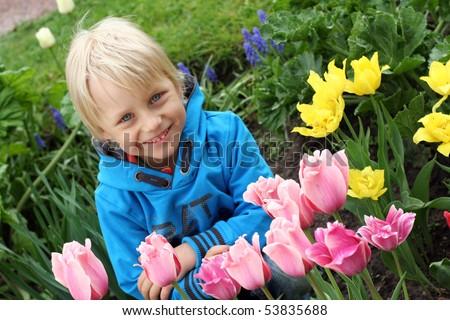 Very cute boy in tulip park in Helsinki - stock photo