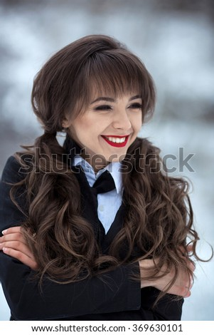 Very cute,happy,lucky,smiling,nice,attractive,lovely,friendly,kind,good,fashionable girl,student with stylish uniform,has good marks,well pass exams with flying colors,demonstrate good mood in winter. - stock photo