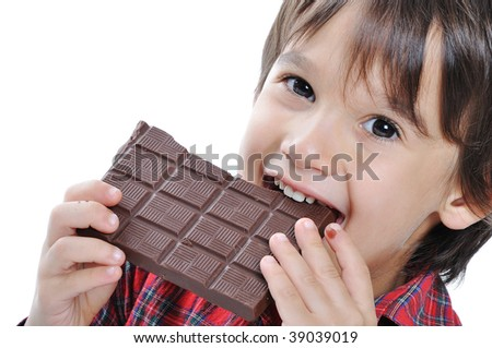 Very cute kid with chocolate, isolated - stock photo