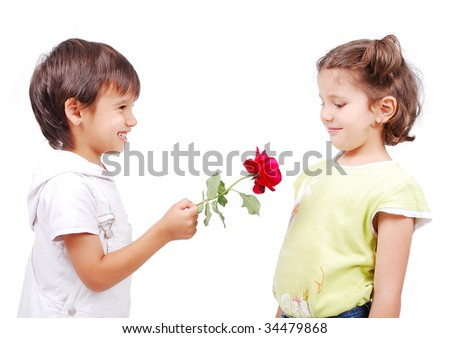 Very cute scene of two little children with rose - stock photo
