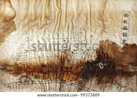 very damaged paper city map with Japanese kanji - stock photo
