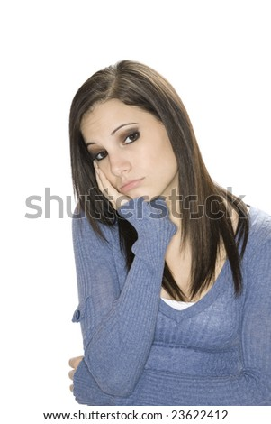 Very depressed Caucasian woman on a white background - stock photo