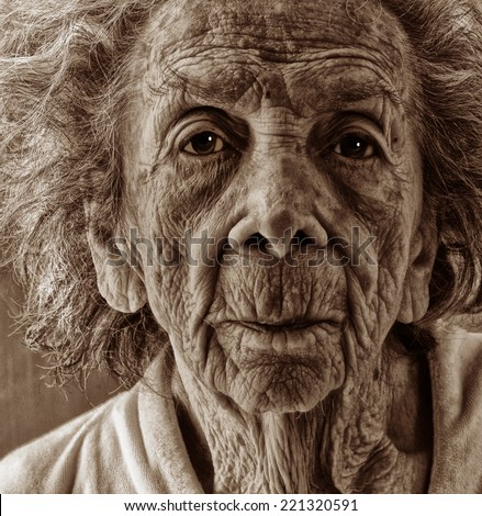 Very emotional Black and White Image of a Old woman - stock photo