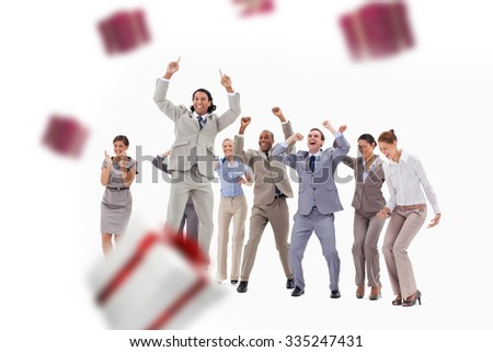 Very enthusiast business people jumping and raising their arms against white and red gift box - stock photo