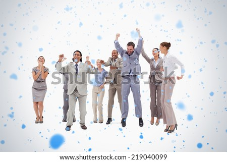 Very enthusiast people jumping and raising their arms against snow falling - stock photo