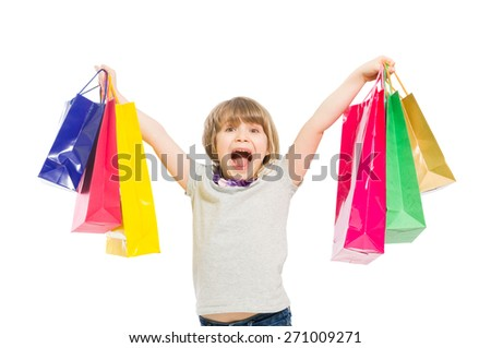 Very excited and enthusiastic young shopping girl shouting - stock photo