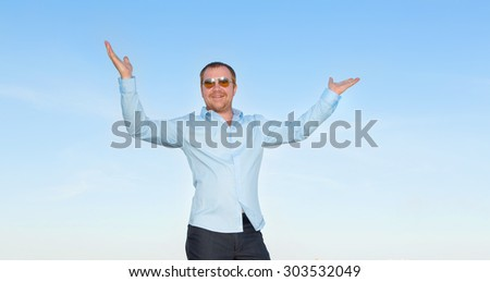 Very excited business man with his arms in the air shot.  - stock photo