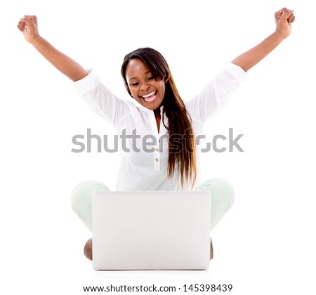 Very excited woman with a laptop and arms up - isolated over white  - stock photo