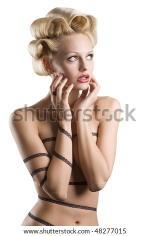 very fashion shot of attractive blond girl with hair stylish and a strip lace around her naked body making face - stock photo