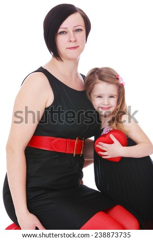 Very fashionable mom and daughter in black and red dress.Isolated on white background studio photo. - stock photo