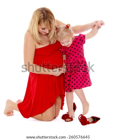 very fashionable mom and daughter try on stylish shoes - isolated on white. - stock photo