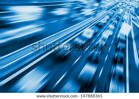 very fast cars on highway (blurred) - stock photo
