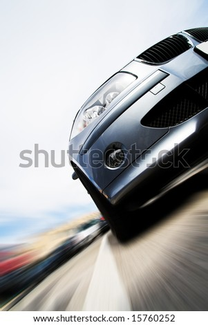 Very fast vehicle moving with motion blur