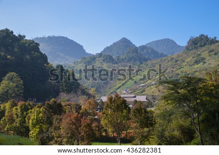 very foggy morning at doi angkang at chiang mai, thailand. landscape of mountains in multiple layers - stock photo