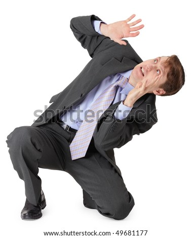 Very frightened businessman sitting on a white background - stock photo