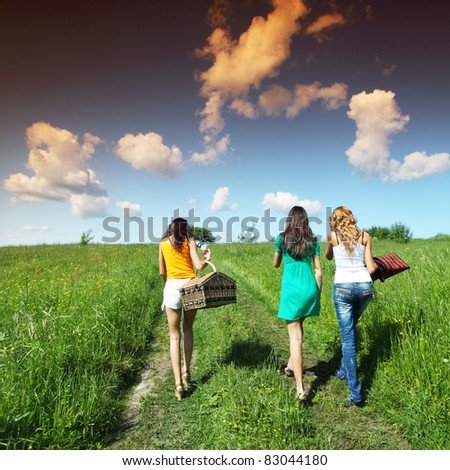 very fun girlfriends on picnic - stock photo