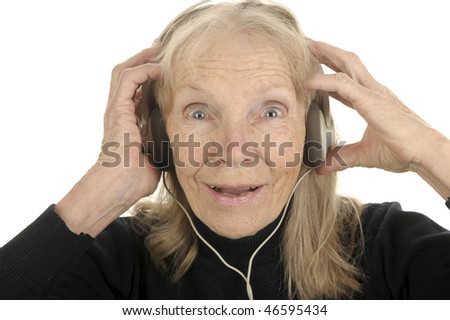 Very Fun Image of An Older woman listening to music - stock photo