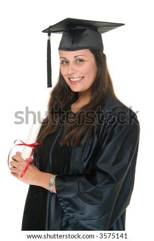 Very happy and proud beautiful young woman in graduation robe, cap & gown smiling and holding her diploma or degree. She has moved the tassle from the left to the right side of the mortarboard. - stock photo