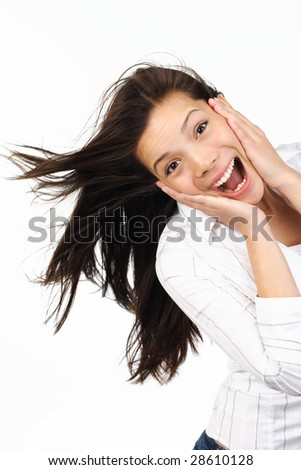 Very happy and surprised eurasian woman holding her head in amazement