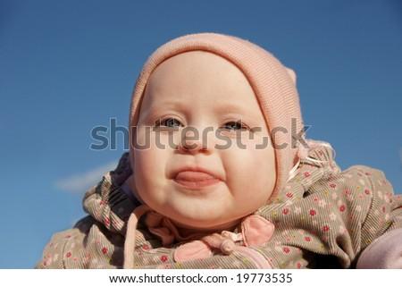 very happy baby girl in blue sky - stock photo