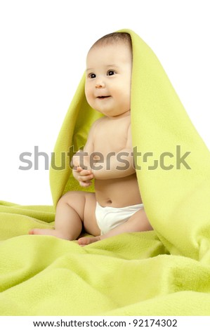 very happy, beautiful,  joy, little kid , sit under  green  blanket  and  smile on white  background, isolated - stock photo