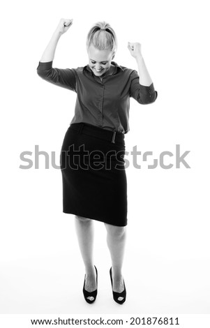 very happy business woman with her arms up in the air to celebrated her achievement - stock photo