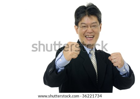 Very happy businessman with his arms raised - stock photo