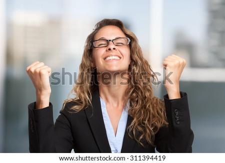 Very happy businesswoman portrait - stock photo