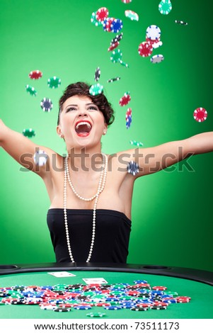 very happy casion lady winning and throwing chips in the air - stock photo