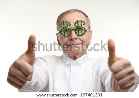 Very happy man making the thumbs up positive hand sign  - stock photo