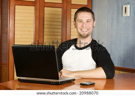 Very happy man sitting at computer