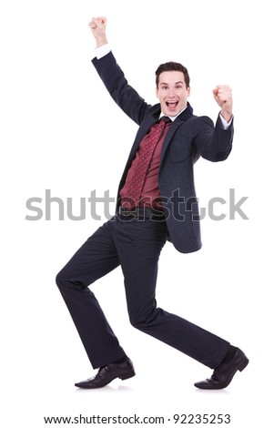 Very happy successful gesturing business man, isolated on white - stock photo