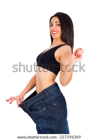 Very happy woman cheering in her big trousers. - stock photo