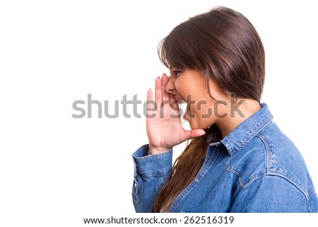 Very happy woman screaming at someone, isolated over a white background - stock photo