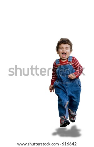 Very happy young boy toddler running towards the camera