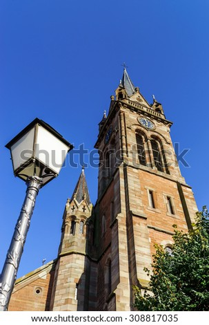 Very high belltower of cathedral in Dambach la Ville, Alsace, France