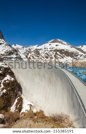 Very high made of concrete Emosson hydroelectric dam near village of Chatelard, Swiss on the border with France - stock photo