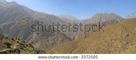 Very high mountains with snowed peaks not far from the sahara desert - Setti Fadma Atlas - Ourika valley - Morocco - Panorama. - stock photo