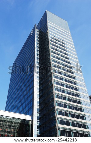 very high office building made of glass and steel - stock photo