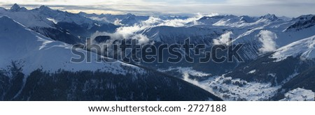Very high resolution alpine panorama showing snow covered mountains and dramatic clouds. No sharpening applied. - stock photo