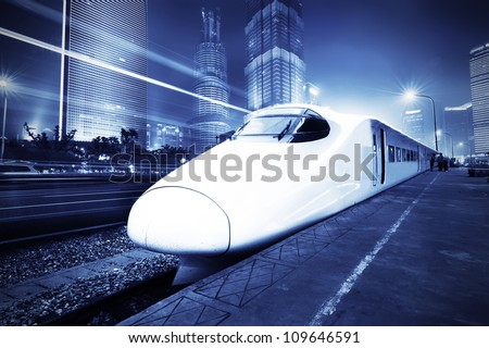 very high-speed train go through the shanghai financial center . - stock photo