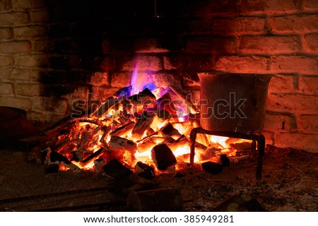 Very hot fireplace burning wood and charcoal - stock photo