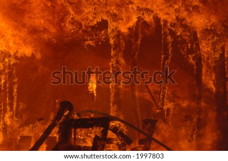 very hot house fire - stock photo