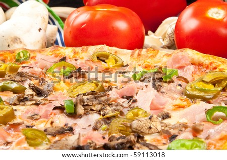 Very hot pizza with different kinds of pepper - stock photo