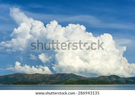 Very Huge clouds Over The Island - stock photo