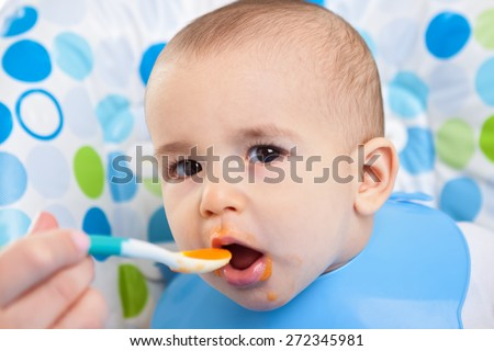 Very hungry baby child close up - stock photo