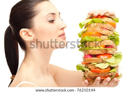 very hungry woman looking huge sandwich, isolated on background - stock photo