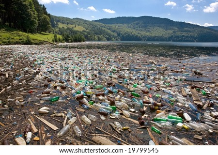 very important plastic and trash pollution on beautiful lake - stock photo